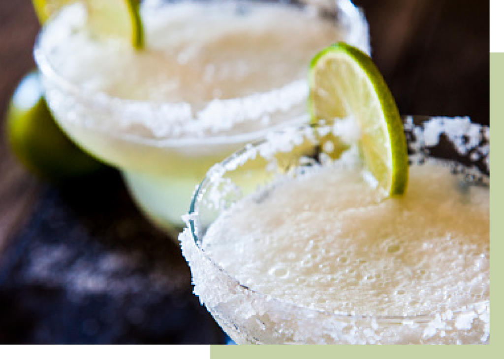 Margarita cocktail with a slice of lime & sugar crystals