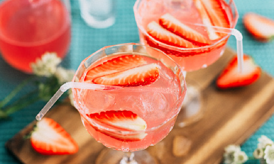 Bright strawberry cocktails with straw